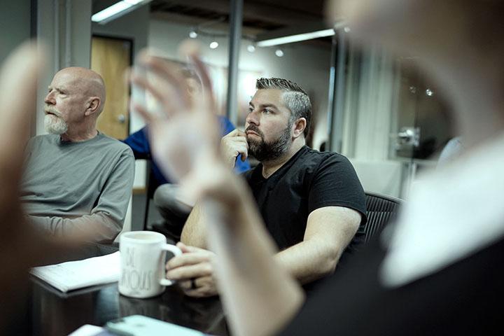 REGROUP team members listening in meeting